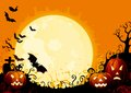 Happy halloween three glowing pumpkins and many flying bats on abstract background with graveyard and big moon Stock Photo