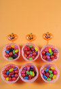 Happy halloween trick or treat candy on bright colorful modern orange background childrens party favors Stock Image