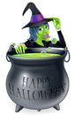 Happy halloween witch and cauldron a cartoon looking over her bubbling with a written on it tipping her hat Stock Photo
