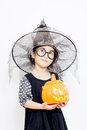 Happy halloween witch child with pumpkin in dress Royalty Free Stock Images