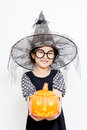 Happy halloween witch child with pumpkin in dress Royalty Free Stock Photos