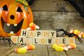 Happy Halloween wooden blocks with candy corn and decor Royalty Free Stock Photo