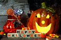 Happy Halloween wooden blocks, night scene with Jack-o-Lantern and candy Royalty Free Stock Photo