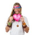 Happy handsome hippie holding a love heart