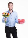Happy handsome man with flowers a gift portrait of and isolated on white Royalty Free Stock Photo