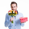 Happy handsome man with flowers a gift portrait of and isolated on white Stock Photos