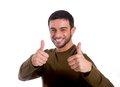 Happy handsome man giving thumbs up smiling the double hand gesture wearing a brown shirt on a white background Royalty Free Stock Photo