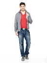 Happy handsome man in grey jacket, blue jeans Royalty Free Stock Images
