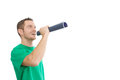 Happy handsome man with megaphone in green orator isolated on white Royalty Free Stock Photography