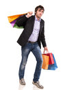 Happy handsome man with shopping bags on a white background Royalty Free Stock Photography