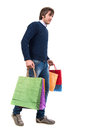 Happy handsome man with shopping bags on a white background Royalty Free Stock Photo