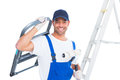 Happy handyman with chair and paint roller on white background Royalty Free Stock Photo