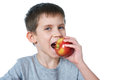 Happy healthy boy eating apple isolated Royalty Free Stock Photo
