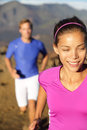 Happy healthy lifestyle running people woman runner smiling during cross country run in beautiful nature female fitness Royalty Free Stock Photography