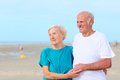 Happy healthy retired elders couple enjoying vacation on the beach loving amusing elderly and sea breeze sunny day active Stock Images