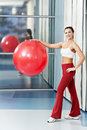 Happy healthy woman with fitness ball Stock Photography