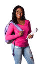 Happy highschool college student smiling female standing with backpack and notepad isolated Royalty Free Stock Photography