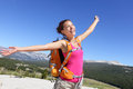 Happy hiker girl hiking carefree in nature young asian adult showing freedom pose after reaching summit mountain Royalty Free Stock Photography