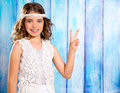 Happy hippie children girl smiling with peace hand sign brunette on blue wood Stock Photo