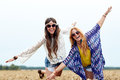 Happy hippie women having fun on cereal field Royalty Free Stock Photo