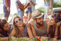 Happy hipsters chatting on the campsite at a music festival Royalty Free Stock Photography