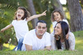 Happy hispanic family smiling parents and children Royalty Free Stock Photo