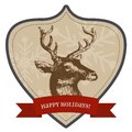 Happy holidays christmas badge and new year greetings with vintage style it reads and has a reindeer the has snowflakes on Royalty Free Stock Image