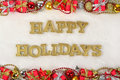 Happy holidays golden text and Christmas decorations on a white Royalty Free Stock Photo