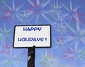 Happy holidays sign with a wish and many colorful explosions in the sky Royalty Free Stock Photos