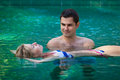 Happy honeymoon in a swimming pool smiling young couple relaxing tropical resort Stock Image
