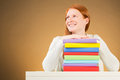 Happy or hopeful college student a caucasian with a stack of colorful books looking away with a smile Stock Images