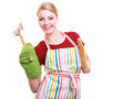Happy housewife apron oven mitten holds kitchen utensil isolated wearing green baking rolling pin and meat hammer studio picture Royalty Free Stock Photography