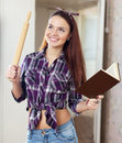 Happy housewife dreams with book Royalty Free Stock Photo