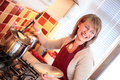Happy Housewife in the Kitchen Stock Image
