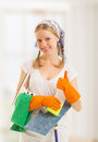 Happy housewife shows a thumb up Stock Photos
