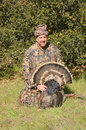 Happy hunter with a turkey in the spring season Royalty Free Stock Photo
