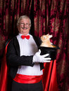 Happy illusionist with rabbit Royalty Free Stock Photo