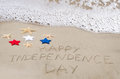 Happy independence day background on the sandy beach near ocean Royalty Free Stock Images