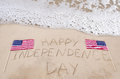 Happy independence day background on the sandy beach near ocean Stock Photography