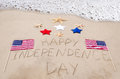 Happy independence day background on the sandy beach near ocean Stock Photo