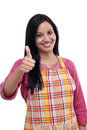 Happy indian woman wearing kitchen apron young and showing thumbs up Stock Photos