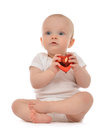 Happy infant child baby girl toddler holding red heart