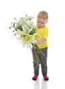 Happy infant child baby toddler standing with boquet of flowers isolated on a white background Royalty Free Stock Photo