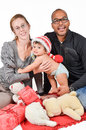 Happy interracial family for christmas is enjoying Stock Photos
