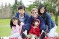 Happy interracial family enjoying day at park Royalty Free Stock Photo
