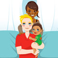 Happy interracial family of white husband and black wife with their mixed race child Stock Photo