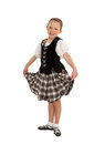 Happy irish dancer girl cheerful young national in ghillies and performance tartan Stock Photo