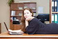 Happy joyful caucasian female laying desk laptop front Royalty Free Stock Images