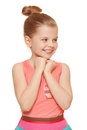 Happy joyful little girl looking sideways in excitement isolated on white background Stock Photos