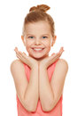 Happy joyful little girl smiling with hands near face, isolated on white background